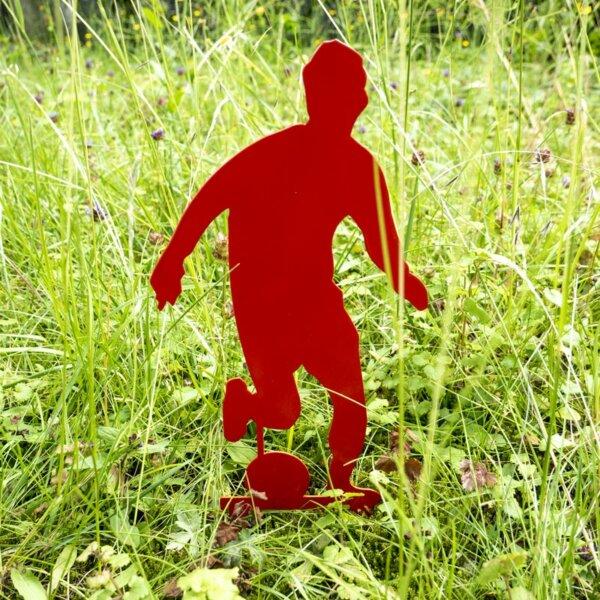 Rotes Fußball-Männchen für den Garten.